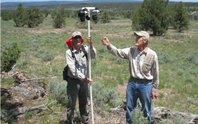 Art Talsma and a volunteer monitor the response of vegetation following juniper control.