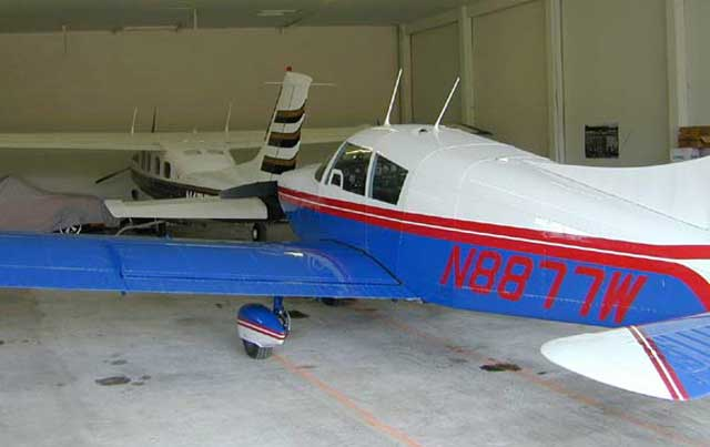Bud Purdy's Piper 235 Cherokee, foreground, is parked next to Nick Purdy's modified Cessna 210 in a hanger behind the Silver Creek store. The Cessna has a Rolls Royce engine and a pressurized cabin