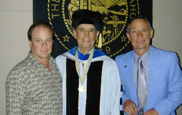 Bud received an honorary degree in natural resources from the University of Idaho. With him are his son, Nick, right, and his grandson, Randy, left