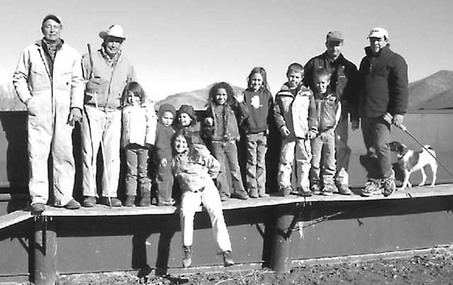 Four generations of the Purdy family pose for a photo at the ranch. Ranching teaches kids a sound work ethic, Bud says, just like it did for him