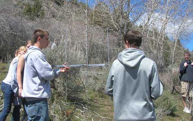 The Borah High students learned how to use radio telemetry equip-ment as part of the field trip. They searched for a radio collar hidden in the sage brush.