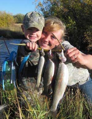 The Tyler family likes to fish and hunt, too. They catch lots of nice trout in the Lemhi River. Here, daughter Kristine catches fish with her son, Braxton.