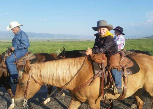 This little feller, Braxton, middle, could be the next generation to run the Little Eight Mile Ranch, along with his sister, Alexa, right. Also pictured is Angel Crosthwaite on the left.