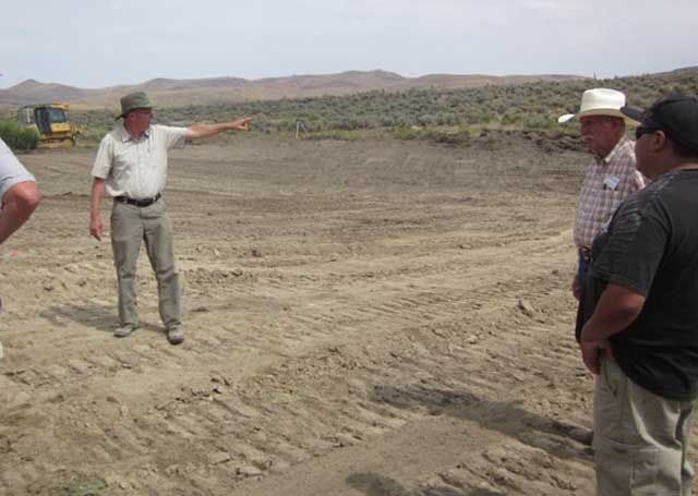 Wetlands expert Tom Biebighauser talks about the design features of the Hoagland pond in the Reynolds Creek area. The pond is located near a sage grouse lek, and it also will be valuable for waterfowl and other critters.