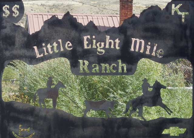 The sign for the Little Eight Mile Ranch features the Chevy logo, Tyler's initials and one of their livestock brands.