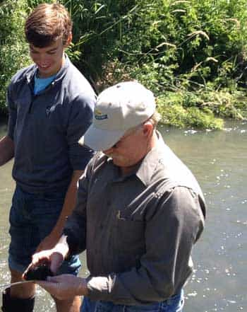Philip Soulen and science teacher Stuart Nesbitt from Weiser High take some water quality samples