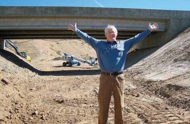 Ed Bottum celebrates the new wildlife underpass on Idaho 21. It should reduce winter road kiill mortality for deer and elk. (Photo courtesy Idaho Fish and Game.)